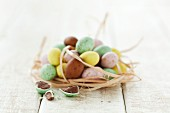 Mini chocolate eggs in an Easter nest