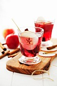Warm cherry drinks with apple and cinnamon