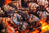 T-bone steaks on a barbecue