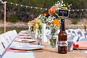 A table laid outside for a wedding reception