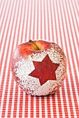 A Christmas apple decorated with a snow star