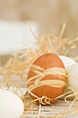 Dyed Easter egg on straw mat