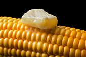 A hot corn cob with melting butter