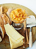Sweet pineapple and onion chutney, bread and cheese