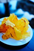 A plate of homemade potato crisps