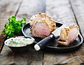 Pork fillet with herb sauce
