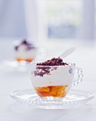 A verrine with cream, maple syrup and cocoa powder