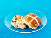 A hot cross bun with butter