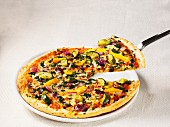 A pizza topped with Mediterranean vegetables