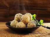 Steaming bread dumplings with parsley
