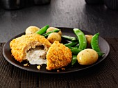 Chicken Kiev with mange tout and potatoes