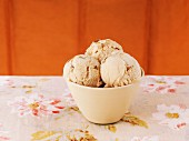 A bowl of butterscotch ice cream