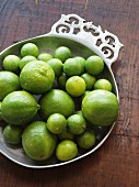Large and small limes in a pewter bowl