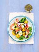 A salad with melon, mozzarella, rocket and Parma ham