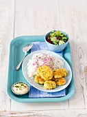 Egg patties with rice and red onions