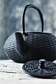 A cast iron oriental tea pot (close-up)