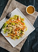 Sesame chicken salad with carrots and ginger dressing (Asia)