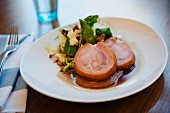Roast Porchetta (pork roulade, Italy) with a side salad