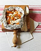 Carrots with taragon and goat's cheese in aluminium foil