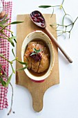 Duck in a gingerbread sauce with cranberries
