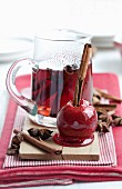 Christmas mulled wine with a spiced toffee apple