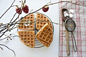 Waffles with butter and honey under a Christmas sprig