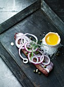 Herring fillets with capers, red onions and egg yolk
