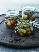 Pickled unripe strawberries in glass jars