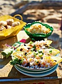Rice salad with kidney beans and sweetcorn in chicory leaves for a picnic