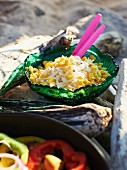 White cabbage salad with sweetcorn for a Caribbean picnic on a beach