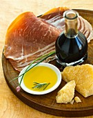 Sliced Prosciutto with Parmesan, chives, balsamic vinegar and olive oil