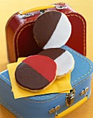 Black and white cookies on small suitcases