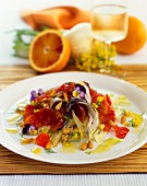 Fennel salad with blood orange, pansies and pine nuts
