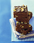 A stack of brownies with walnuts