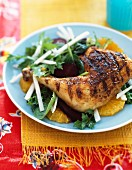 Roast chicken leg on an orange salad with beetroot