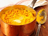 Carrot puree with butter in a copper saucepan