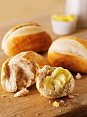 French baguette rolls, one spread with butter