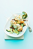 Scallop skewers on a bed of courgette and dried tomatoes