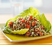 Tabbouleh served in a green lettuce leaf