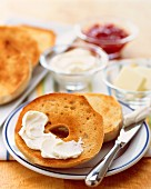 Toasted bagels with cream cheese and jam