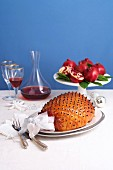 Roast ham studded with cloves and glazed with pomegranate syrup