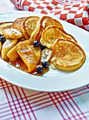 Liwanzen (Austrian pancakes) with banana caramel and blueberries