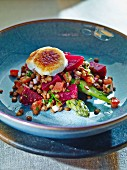 Caramelised goat's cheese on a bed of warm vegetables