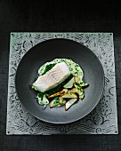 Steamed halibut on a bed of creamy spinach with fried potatoes