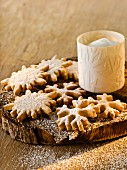 Anise and marzipan snowflakes with icing sugar