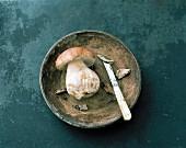 A fresh porcini mushroom in a bowl