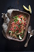 Couscous salad with pomegranate seeds and mint