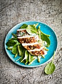 Chicken salad with a coconut and chilli dressing and spinach