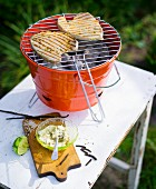 Tuna fish steaks on a barbecue with vanilla butter