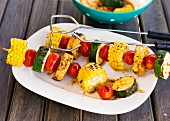 Vegetable skewers with tomatoes, corn and courgette
